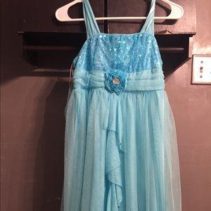 a beautiful blue sparkly dress